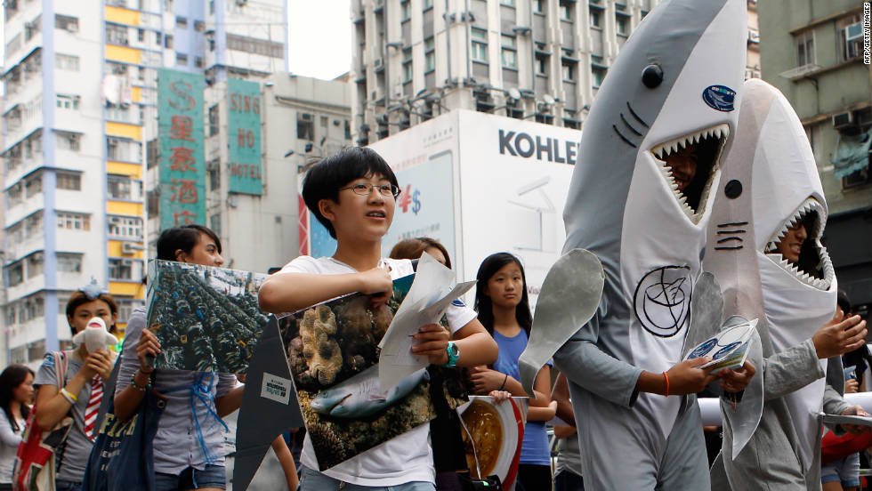 Supporters of the Hong Kong Shark Foundation march along a street to raise awareness for sharks killed each year for their fins, in Hong Kong on September 25.