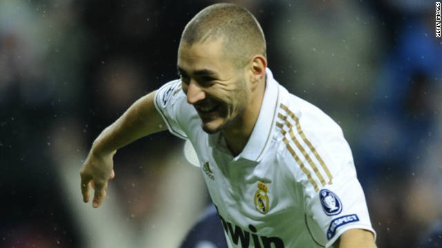 Karim Benzema celebrates a goal during is side's rout of Dinamo Zagreb in the Bernabeu.
