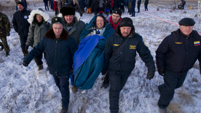 Astronaut Mike Fossum smiles as he is carried in a chair to the medical tent just minutes after landing in Kazakhstan.