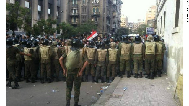 Military separates police, protesters