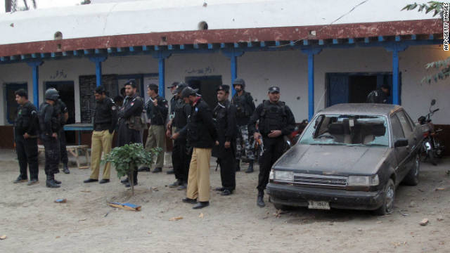 Pakistani policemen gather at a police station following an attack that killed two officers. The Taliban has claimed responsibility.
