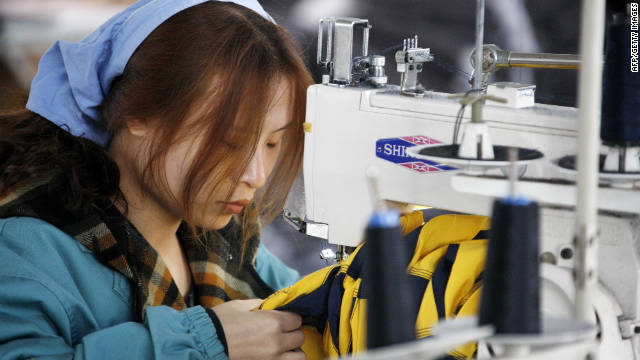 A Chinese worker goes about her chores at a textile factory in Huaibei, east China's Anhui province on November 21.