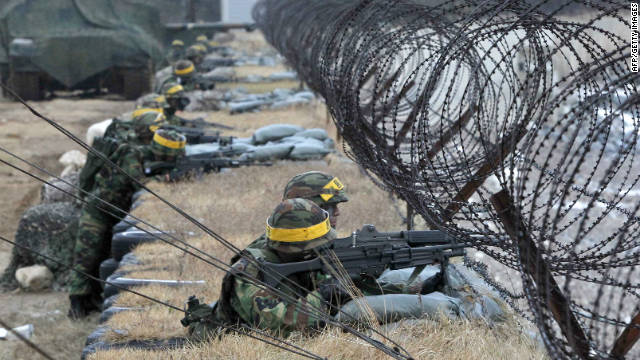 South Korean Marines mark the first anniversary of North Korea's artillery attacks on Yeonpyeong Island on November 23.