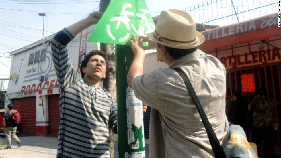 """The activists are all part of a local Mexican organisation known as the """"Make Your City Collective"""" who raised funds for the paints, brushes and stencils from a crowdsourcing site."""