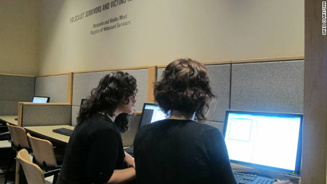 Sara Clark, left, and Andrea Bertrand index documents as part of the World Memory Project.