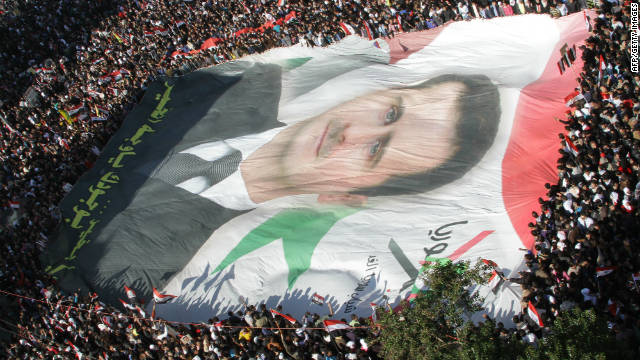 Protesters demonstration against the Arab League decision to impose crippling sanctions on President Bashar al-Assad's regime.