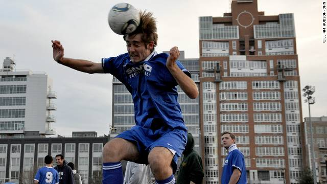 An amateur soccer player in Brooklyn 'heads' the ball.