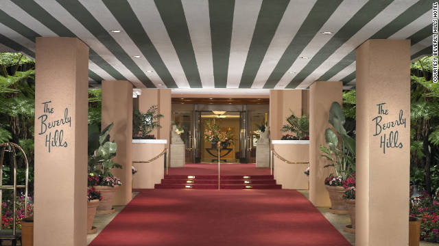 The signature green stripes and red carpet sweep guests into the grand entrance of the Beverly Hills Hotel.