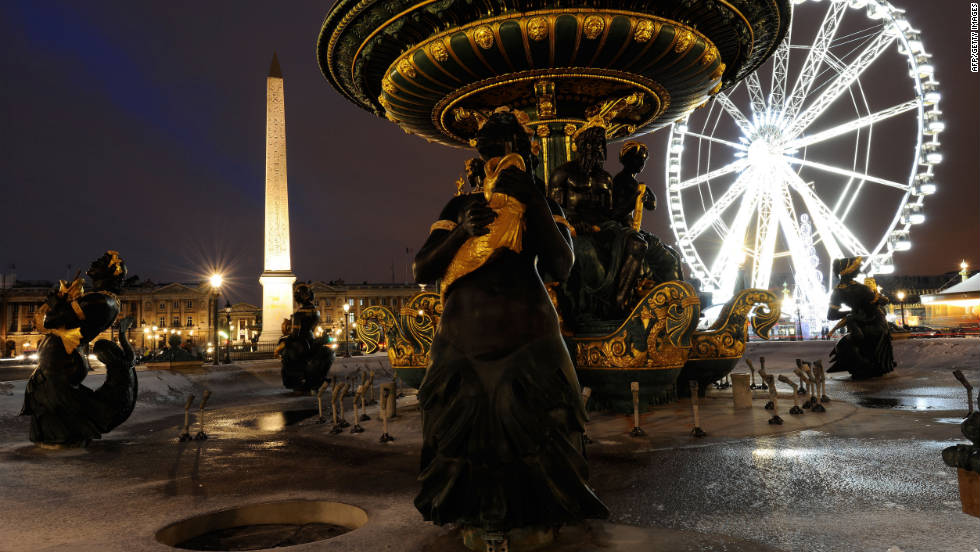 An ice-covered fountain makes for a picturesque scene at the Place de la Concorde.
