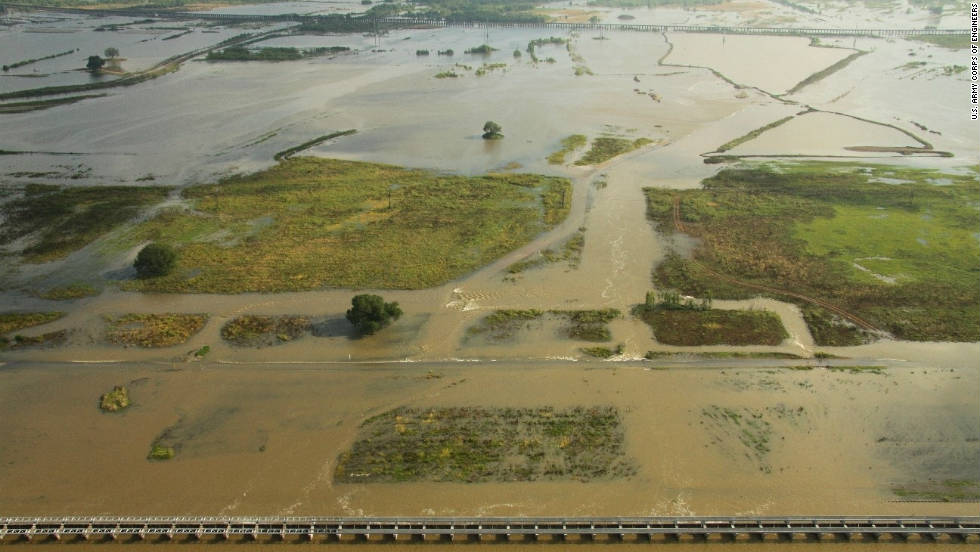Heavy rains combined with melting snow triggered major flooding along the Mississippi River in May 2011.  To alleviate the overflowing Mississippi and its tributaries, the U.S. Army Corps of Engineers opened spillways, like the Bonnet Carre spillway -- pictured here -- just north of New Orleans.   At least two people died and the estimated economic loss ranges from $3 billion to $4 billion.