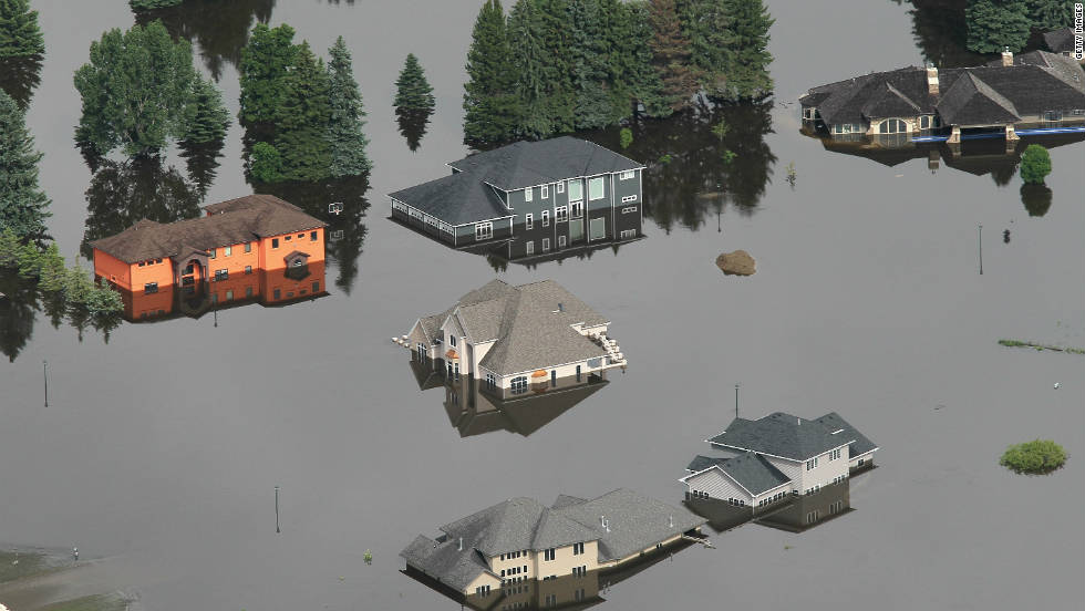 In June, the melting mountain snowpacks dumped massive amounts of water into the Missouri and Souris rivers, causing record flooding in the Upper Midwest.  About 11,000 people were forced to evacuate Minot, North Dakota, pictured here, and thousands of acres of farmland flooded along the Missouri. Five people were killed and estimated losses exceed $2 billion and counting.