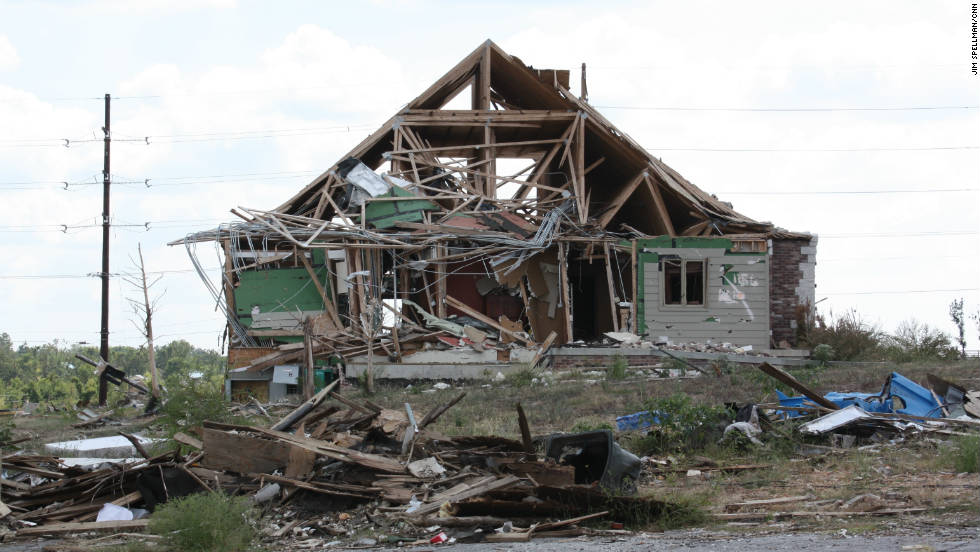 On May 22, an extremely powerful tornado struck Joplin, Missouri, part of a six-day tornado outbreak of 180 twisters in more than a dozen states that caused 177 deaths, most of them in Joplin.  The town is still rebuilding, as shown in this photo taken four months after the tornado -- the single deadliest twister in U.S. history.  Total losses exceeded $9 billion.