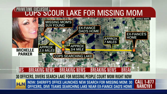 Cops, divers comb lake for missing mom