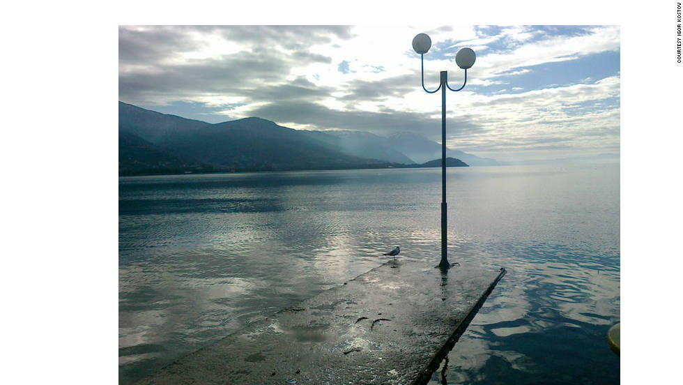 "This picture of Lake Ohrid, a UNESCO World Heritage Center, was taken by Macedonian Igor Kostov. He says climate change has affected his country. ""There (are) lot of problems with lack of rain, but pollution, forest degradation, no control of city building, disappoint me,"" he adds."