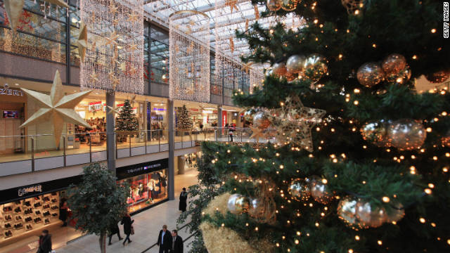 People walk among Christmas decorations in the Potsdamer Platz Arkaden shopping mall.