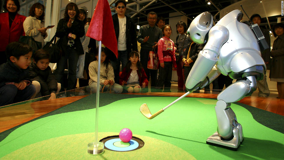 Sony's prototype robot golfer Qrio shows off its skills during a technology exhibition in Japan.