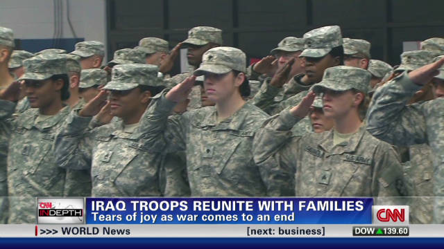 Troops home from Iraq, some to re-enlist