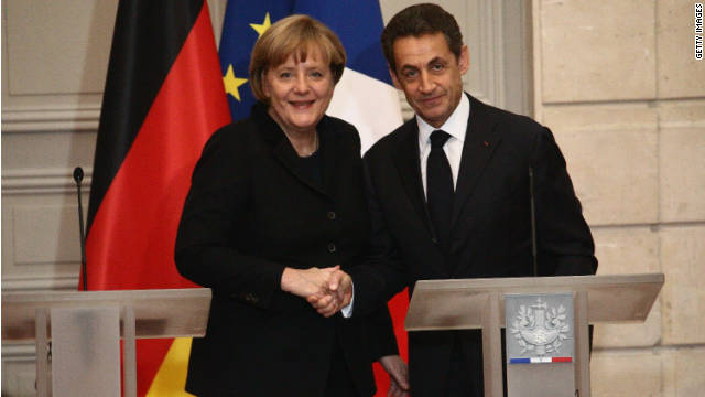 : French President Nicolas Sarkozy and German Chancellor Angela Merkel attend a joint press conference for the launch of Eurozone crisis talks at Elysee Palace on December 5, 2011 in Paris, France.