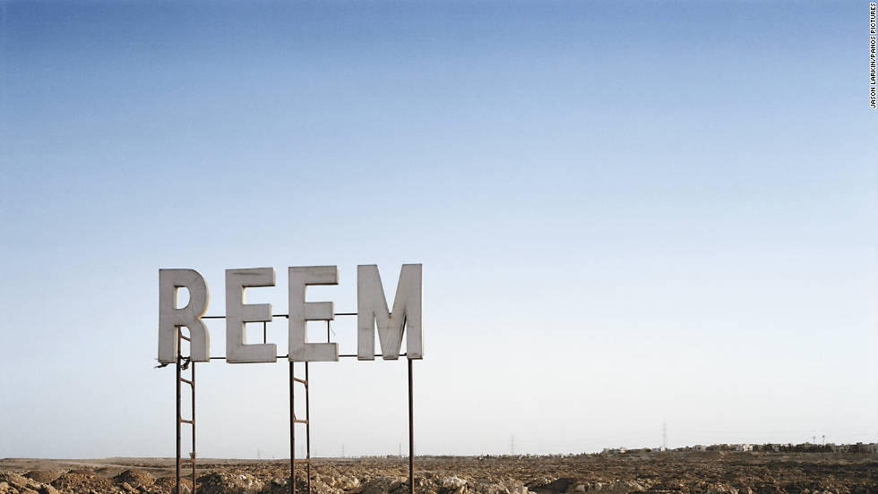 The name of a new plot of desert land set to be developed to the west ofCairo is erected before any other work has taken place.