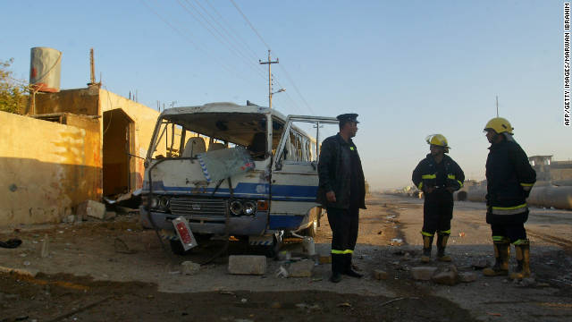 Iraqi firefighters inspect the site of a blast in Kirkuk on December 3.