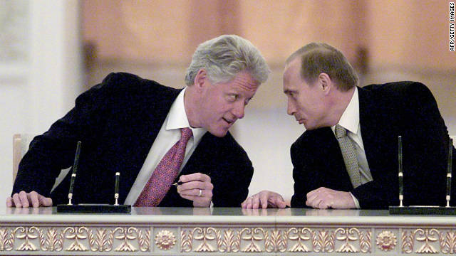 US President Bill Clinton and Russian President Vladimir Putin talk after signing a memorandum at the Kremlin on June 4, 2000, in Moscow.