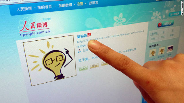 An Internet user points to the account page of China's President Hu Jintao on a microblogging site