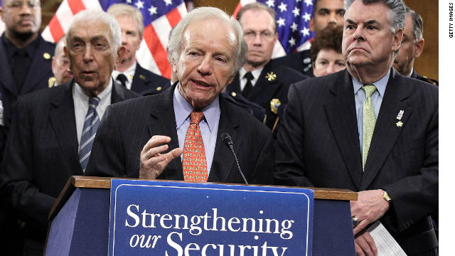 Sen. Joseph Lieberman speaks as Rep. Peter King, right, listens during a news conference November 15, 2011 on Capitol Hill.