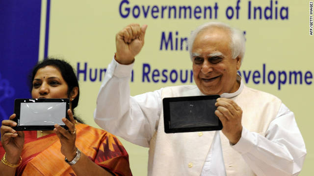 Minister Kapil Sibal, right, has raised alarm bells in India over comments that social media providers should filter defamatory content.