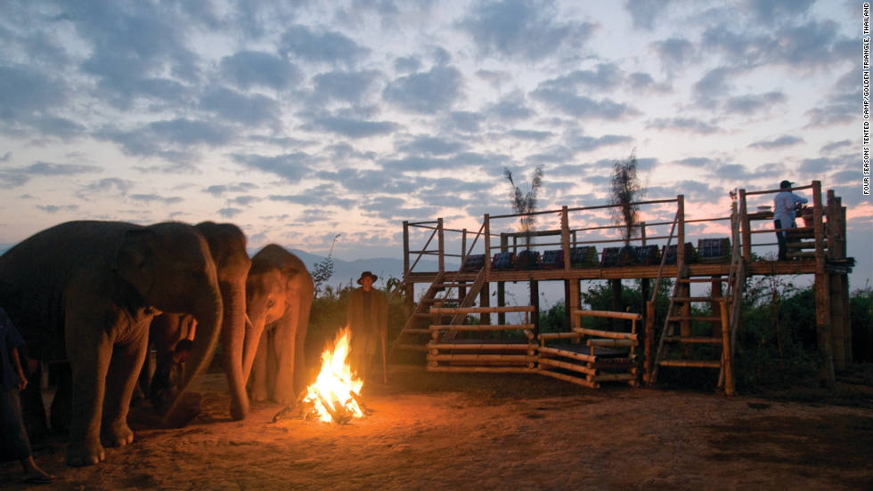 The sun sets on a visit with elephants in Thailand.