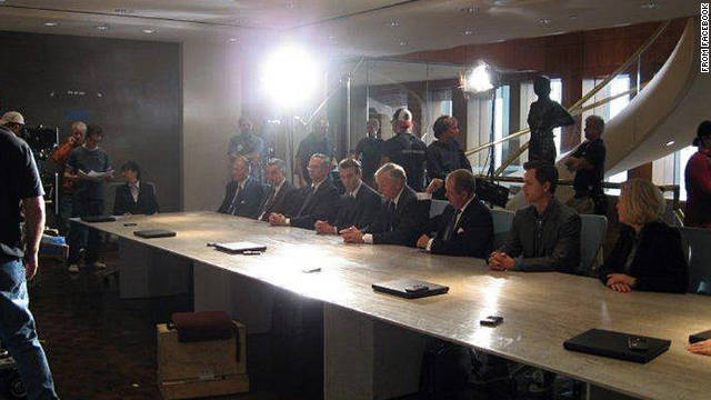"Movie extra Paul Barlow films a boardroom scene for ""The Change-Up"" with actor Jason Bateman."
