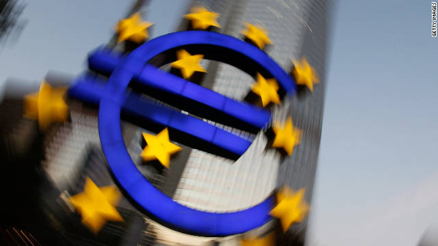 FRANKFURT AM MAIN, GERMANY - SEPTEMBER 27: (EDITORS NOTE: This image has been altered: camera was rotated during long time exposure.) The symbol of the European common currency, the Euro, stands past the headquarters of the European Central Bank (ECB) on September 27, 2011 in Frankfurt am Main, Germany. Europe is continuing to wrestle with the ominous prospect of a Greek debt default that many fear could spread panic and push the already fragile economies of Italy, Portugal and Spain into a crisis that would rock the Eurozone and lead to global repercussions. On Thursday the Bundestag, under the urging of German Chancellor Angela Merkel, is expected to pass an increase in funding for the European Financial Stability Facility (EFSF), a measure many see as necessary for financial markets to regain confidence in the European banking system. (Photo by Ralph Orlowski/Getty Images)