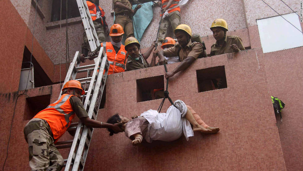 Rescuers used blankets and ropes to help those trapped in the five story building