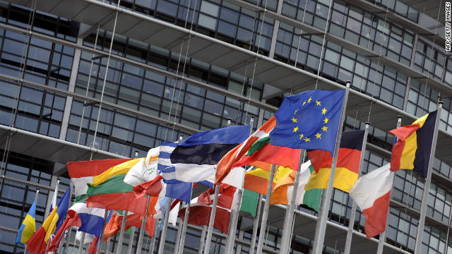 Flags of the European Union nations fly in front of the European Parliament.