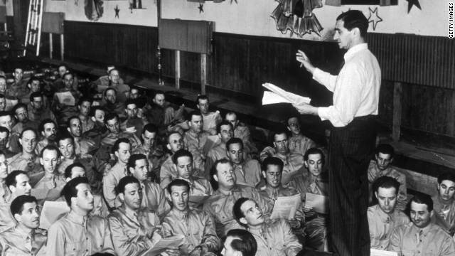 Composer Irving Berlin leads a group of servicemen at Camp Upton on Long Island, New York, in 1942.
