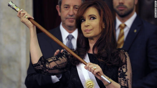 Argentina's reelected President Cristina Kirchner with the presidential sash and stick after her inauguration in Buenos Aires, on December 10, 2011.