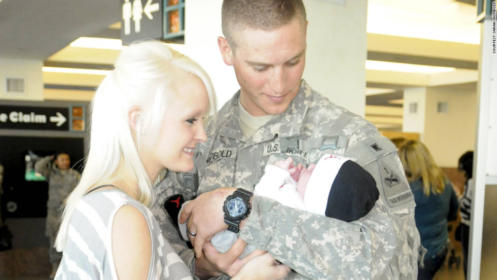 "In a moment that both Josh and Sarah describe as ""mind-blowing,"" Josh holds his son, Trae, for the first time after arriving home from Iraq in early November."