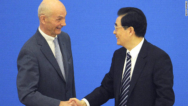 Chinese President Hu Jintao (right) shakes hands with Pascal Lamy, Director-General of the WTO in Beijing on December 11.