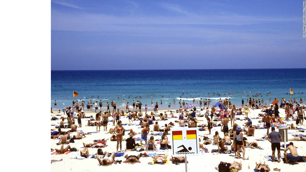 Thousands of locals and visitors descend upon Bondi Beach on a warm summer's day.