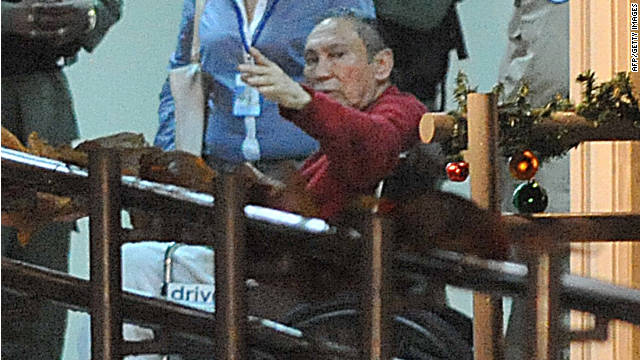 Former Panamanian dictator Manuel Noriega, in red, arrives at El Renacer prison near Panama City on Sunday.