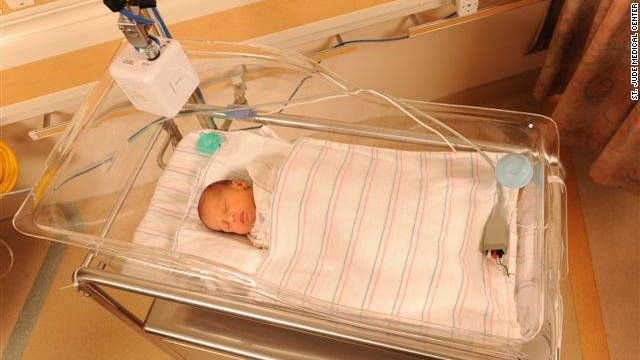 An infant sleeps in the neonatal intensive care unit at St. Jude Medical Center in Fullerton, California, watched over by a webcam.