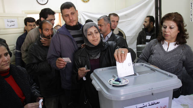 Syrians line up to vote in local elections in Damascus on Monday.