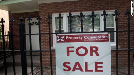 CHICAGO, IL - MAY 31: A 'For Sale' sign stands in front of a house on May 31, 2011 in Chicago, Illinois. According to the Standard & Poor's Case-Shiller Home Price Index home prices fell in March in 18 of the 20 metropolitan areas monitored by the index, reaching their lowest levels since the housing bubble burst in 2006. In Chicago, were nearly 30 percent of homes offered for sale are bank owned, prices have fallen 7.6 percent from a year ago. (Photo by Scott Olson/Getty Images)