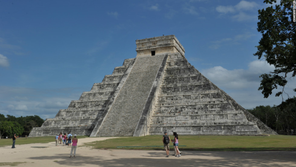 Tourists check out Mayan ruins in Chichen Itza, Mexico.
