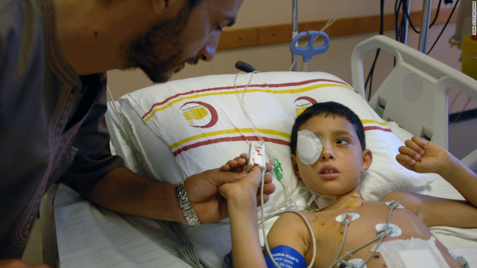 Eight-year-old Sulah Yonis in Benghazi Hospital. His father and sister were killed instantly after his three-year-old sister pulled the pin out of a hand grenade she found. His mother and two other children were seriously injured.