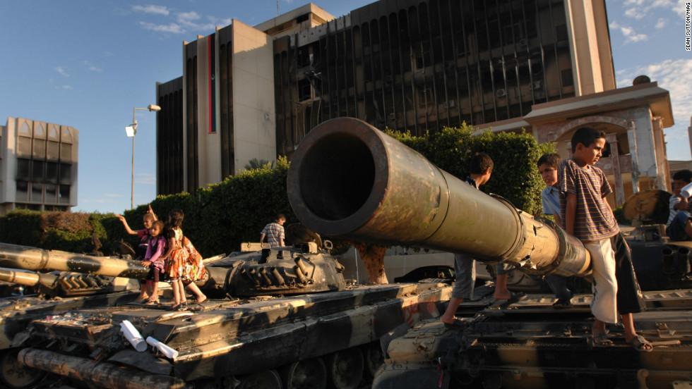 Children play on destroyed tanks in Misrata.