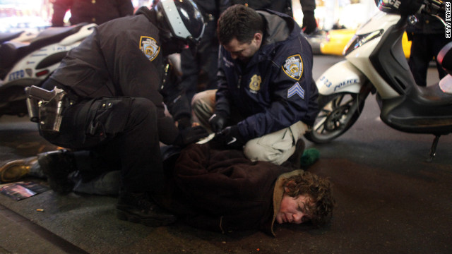 A protester is arrested during Saturday's Occupy Wall Street demonstration in New York.