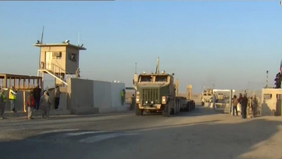 A U.S. cargo trailer crosses the Iraq-Kuwait border for the final time.