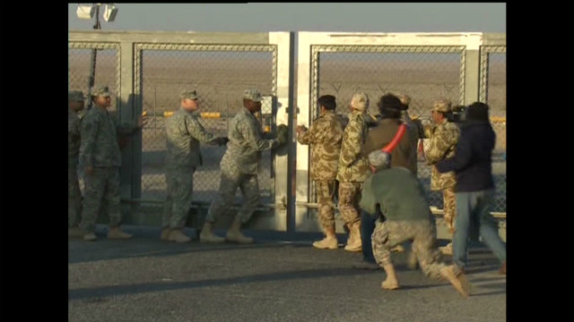 Gates close at the Iraq-Kuwait border