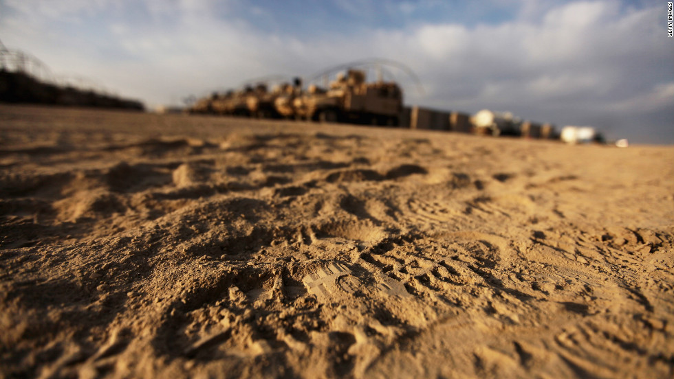 Boot footprints are seen in front of U.S. Mine Resistant Ambush Protected (MRAP) vehicles in the nearly deserted Camp Adder, now known as Imam Ali Base, on December 16.