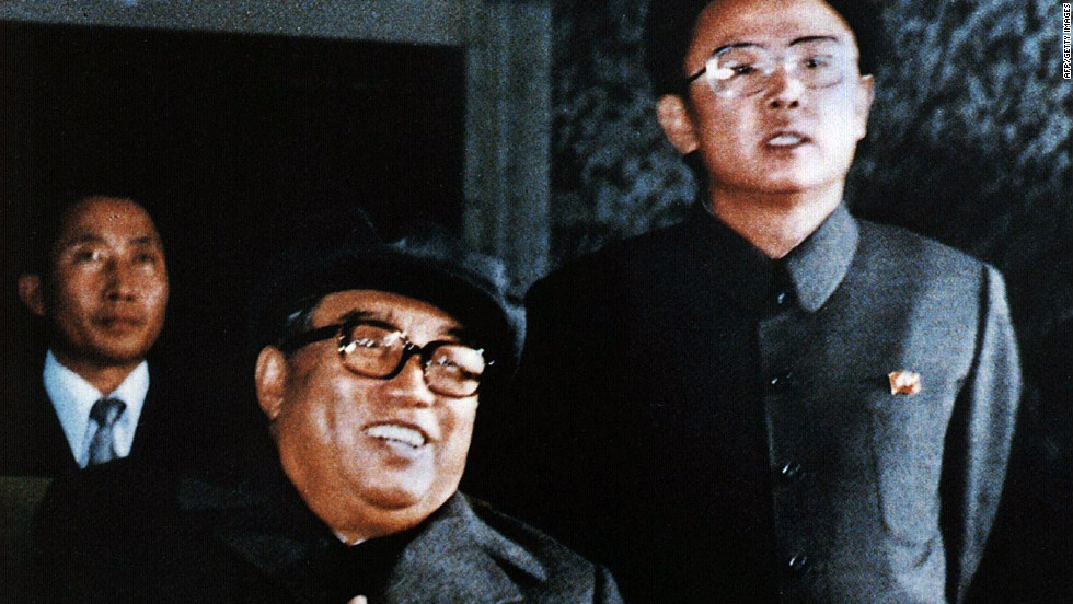 Former North Korean leader Kim Il Sung and his son and chosen successor, Kim Jong Il, attend a party to celebrate the sixth Korean Workers' Party convention in October 1980.